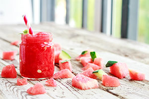 fruit slush served as a drink or a dessert in a glass jar